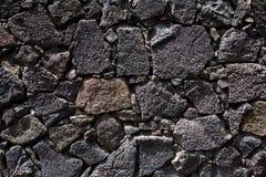 Parete di massoneria del nero della pietra della lava di Lanzarote Fotografie Stock