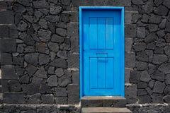 Parete di muratura di pietra blu della lava della porta a La Palma Fotografia Stock Libera da Diritti