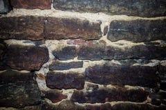 Parete di pietra antica fatta delle pietre di forma rettangolare oblunga Parete russa antica della fortezza, Fotografia Stock