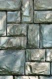 Parete di pietra con indicatore luminoso ed ombra Immagini Stock