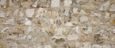 Parete di pietra del vecchio granito con la cucitura del cemento, lavoro in pietra ampio Backgrou Immagini Stock Libere da Diritti