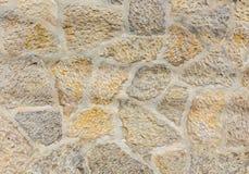 Parete di pietra di rugosità antica Lavoro in pietra di arenaria Fotografie Stock Libere da Diritti