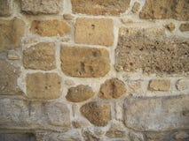 Parete di pietra di vecchia costruzione, colore della sabbia, fondo di pietra Fotografia Stock