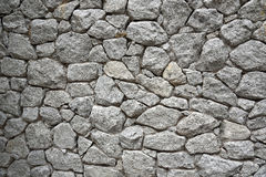 Parete di pietra grigia naturale Fotografia Stock