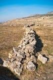Parete di pietra rovinata di Hierapolis antico Immagine Stock