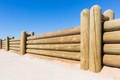 Parete di Wood Poles Low del recinto Fotografia Stock Libera da Diritti