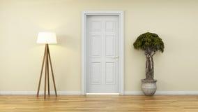 Parete gialla con la porta e la pianta bianche Fotografia Stock