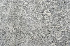 Parete grigia del granito con tonalità beige di vecchia costruzione Priorità bassa strutturata immagini stock libere da diritti