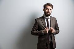 Parete grigio chiaro dell'uomo d'affari Fotografie Stock Libere da Diritti