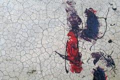 Parete incrinata con il backgrou nero e rosso di struttura dell'estratto della pittura Immagini Stock Libere da Diritti