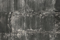 Parete nera dei blocchi in calcestruzzo in uno stile di lerciume Fotografia Stock