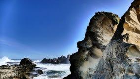Parete rocciosa della spiaggia Fotografia Stock