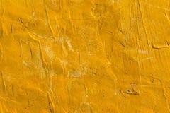 Parete ruvida di giallo di struttura Fotografia Stock Libera da Diritti