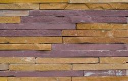 Parete ruvida moderna di struttura del mattone, backg approssimativo variopinto del muro di mattoni Immagine Stock