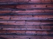 Parete stagionata bruciata rustica di terracotta di marrone scuro del fondo di stile naturale dei ceppi di legno Fotografia Stock Libera da Diritti