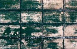 Parete verde coperta di tegoli Grungy Fotografia Stock Libera da Diritti