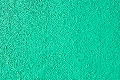 Parete verniciata verde intenso dello stucco fotografia stock