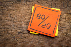 Pareto principle on sticky note. Pareto principle or eighty-twenty rule represented on a sticky note against rustic wood - a reminder or advice royalty free stock photos