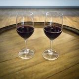 Parexponeringsglas av rött vin Royaltyfria Bilder