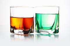 Parexponeringsglas med coctailen Arkivfoton