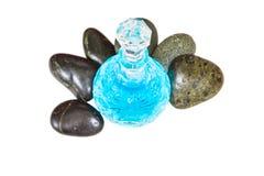 Parfümflasche und Zen Stone II Stockfoto