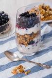 Parfait breakfast. Parfait-style healthy layered breakfast with yougurt,fresh blueberries,muesli or granola Stock Photography