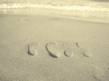 parfotspår älskar sanden Arkivfoton
