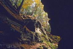 Parfrey glen. Trees and conglomerate sandstone cliff-face (face silhouetted in right cliff) at Merrimac wisconsin united states of america Parfrey's Glen State stock photography