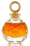 Parfum dans un beau choc en verre Photo stock