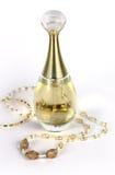 Parfum et collier Photographie stock libre de droits