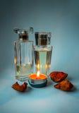 Parfum met een kaars… Stock Foto