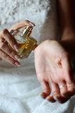 Parfume. Young woman hands with a boutle of parfume stock photography