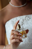 Parfume. Young woman hands with a boutle of parfume royalty free stock photos