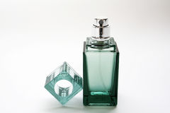 Parfume bottle. Green parfume bottle isolated on white Royalty Free Stock Photos