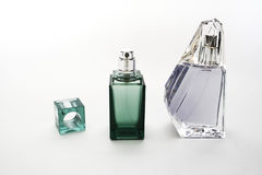 Parfume bottles. Green parfume bottle isolated on white Stock Photos