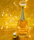 Parfume Dior gold bokeh background bolls glitter. Parfume gold bokeh background bolls glitter shine celebrity love still-life stock photography