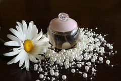 Parfume, pearls, flower Royalty Free Stock Image