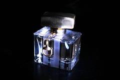 Parfume su una priorità bassa nera Fotografia Stock Libera da Diritti