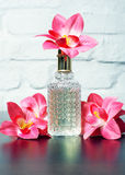 Parfume with tender flowers Stock Photos