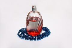 Parfumfles en koralen Stock Foto's