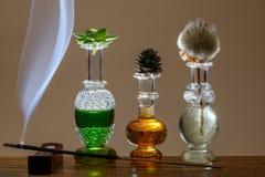 Parfums en rook stock foto's