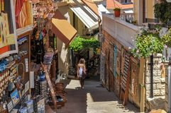 Parga, Epirus - Greece. Narrow alley in the town of Parga, gift shops, souvenirs. Parga, Epirus - Greece. Narrow alley at the town of Parga, gift shops stock image