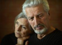 pargamla människor ståendepensionär två Arkivfoto