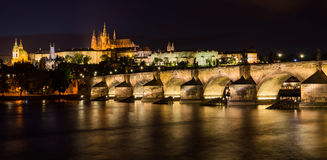 Pargue at dusk, view of the Lesser Bridge Tower of Charles Bridge Stock Photos