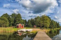 Pari di legno e case scandinave di stile Fotografia Stock