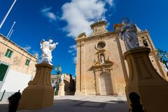 The Parich Church Balzan Malta. Beautiful sandstone sacral architecture of the Parich Church in Balzan city on Malta island. Beautiful cityscape in south Europe Stock Image