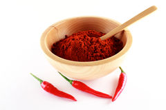 Parika powder and three red chili Stock Photography