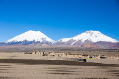 Parinacota and Pomerade volcanos. High Andean landscape in the A. Ndes. High Andean tundra landscape in the mountains of the Andes. The weather Andean Highlands Stock Images