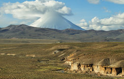 Parinacota and Pomerape volcanoes. View of snow-capped Parinacota volcano, Chile Royalty Free Stock Photography
