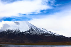 Parinacota Volcano in Northern Chile. Parinacota stratovolcano (6348 meters) and Chungara Lake on the border of Chile and Bolivia on the way from La Paz to Arica Royalty Free Stock Image